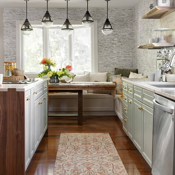 Eat-in kitchen with banquet, pendant lighting and linear marble mosaic wall tile, island with natural quartzite countertop.
