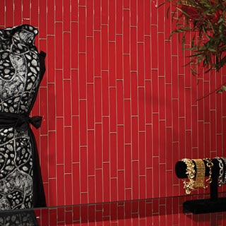 Boutique shop wall with red linear glass tile arranged vertically. Jewelry and evening wear visible on the sides.