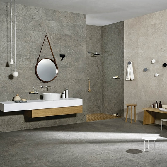 Industrial style bathroom with gray, floor-to-ceiling, concrete look, porcelain tile, concrete look tile floor, and floating vanity.