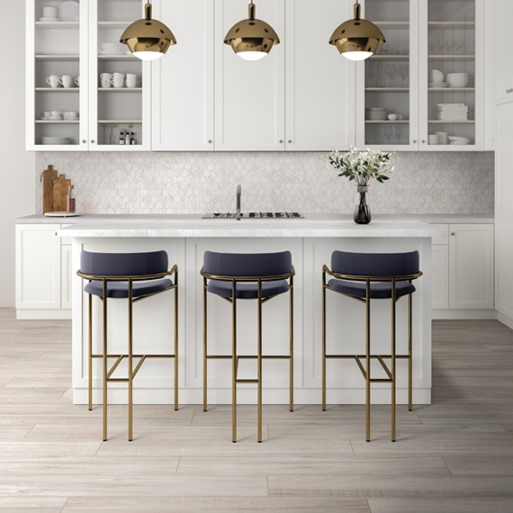 Kitchen with floor tiling that looks like white washed wood, white quartzite countertop, marble look white & beige hexagon tile backsplash, and white cabinets.
