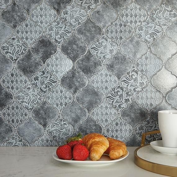 Antique metallic arabesque mosaic backsplash. Tiles have different raised patterns on each tile.