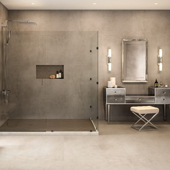 Open concept bathroom with floor-to-ceiling, concrete look, extra-large format porcelain shower with glass enclosure.