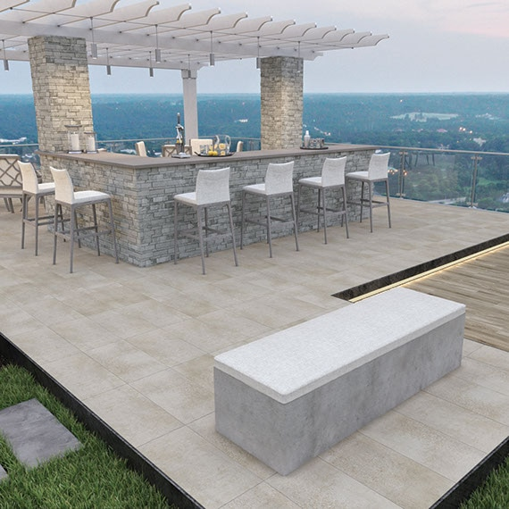 Rooftop patio with stacked stone-faced bar under a pergola.