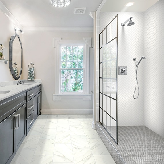 Bathroom with marble look, 12x24, click tile flooring, marble countertop, and shower with white herringbone tile and gray hexagon tile shower floor.