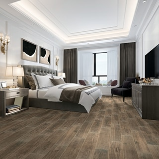 Transitional decor bedroom with deep wood look tile flooring, platform bed with cushioned headboard, wall sconces and recessed ceiling.