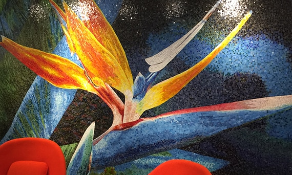Custom mosaic wall depicting a bird of paradise flower in a Daltile showroom.