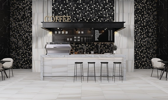 Coffee shop with 12x24, white & beige marble floor tile, black mosaic wall tile, marble countertop, hanging sign with menu.