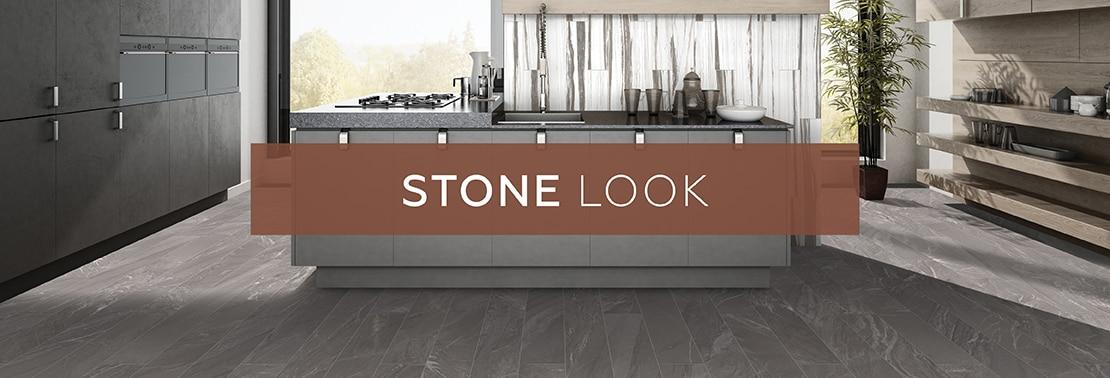 Gray marble look tile with white veining flooring, gray cabinets, floating shelves on white & black marble look backsplash