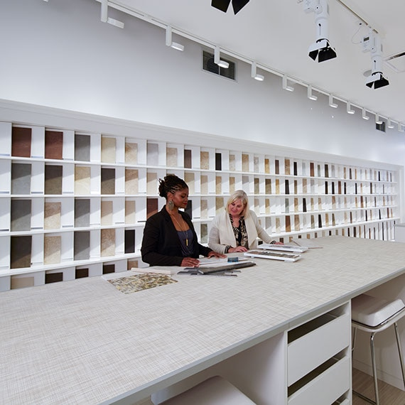 Two women looking at tile samples in the Daltile San Francisco showroom.