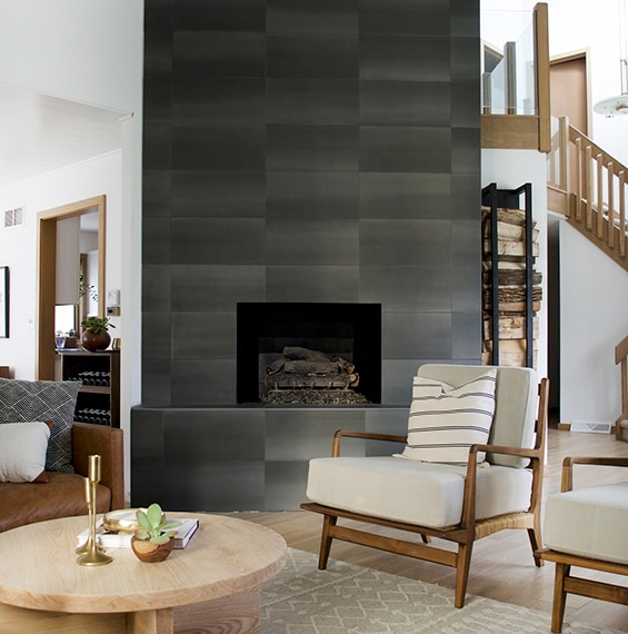 Fireplace in the living room with dark stone look rectangular tiles