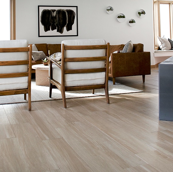 Living room with llight wood look tile in a wide plank on the floor