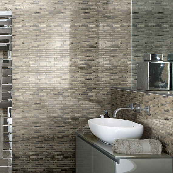 Bathroom with gray glass mosaic tile on the walls
