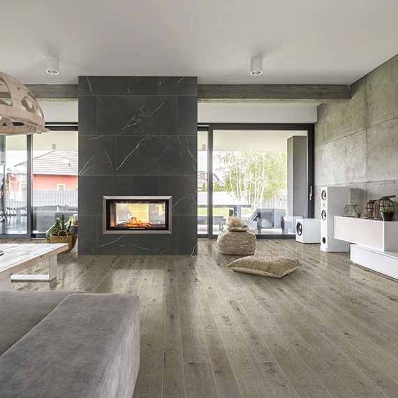 Modern open living room with wood look tile and free standing fireplace