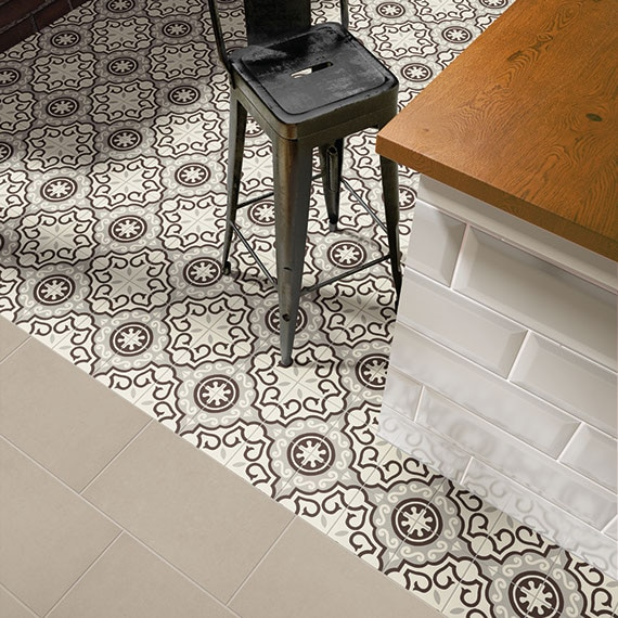 Bird's eye view of kitchen island with encaustic tile in black and gray curvy graphic