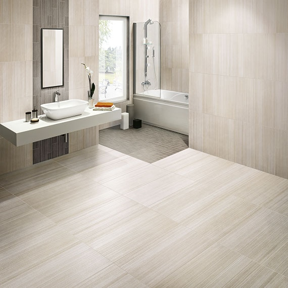 Modern bathroom with textured look large format wall and floor tiles
