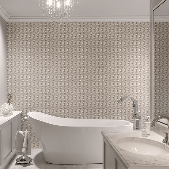 Modern bathroom with pattern wall backsplash behind an elegant bathtub