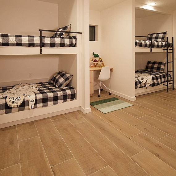 Small bedroom featuring built-in bunk beds with black and white check accessories.