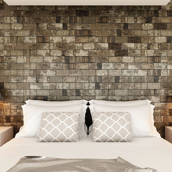 Industrial style bedroom with brick look tile on the wall and queen size bed centered