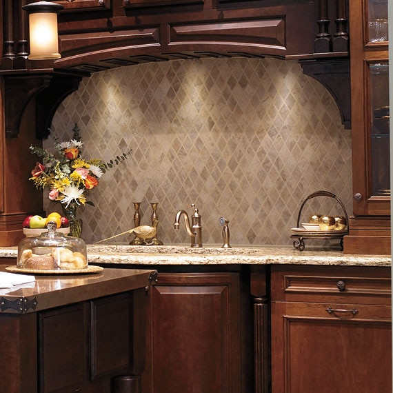 Traditional kitchen with dark wood cabinets and tan diamond pattern mosaic stone tile over the sink