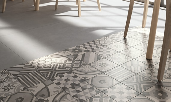 Bistro style restaurant with gray and white encaustic tile rug floor
