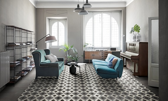 Tile rug in modern living room area with piano and natural lighting