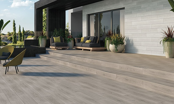 Outdoor patio with wood look tile on the floor and wall
