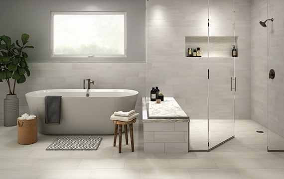Contemporary gray and white bathroom with large soaking tub and walk in shower