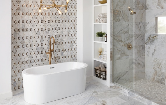 Large bathroom with white and tan marble on the walls and floor with a feature wall of marble mosaic
